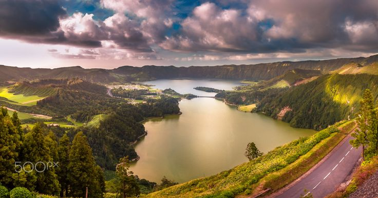 7 Cities Lagoon - Exposure done on the island of São Miguel in the archipelago of the Azores, Portugal. Theses two lakes are known as the Lagoon of the Seven Cities, or Lagoa das Sete Cidades, in Portuguese. They are an important source of fresh water and the largest body of water on the islands. These two lakes are situated in the crater of a dormant volcano and are connected to each other by a natural narrow channel that today has a bridge over it.  Despite the connection, the twin lakes…