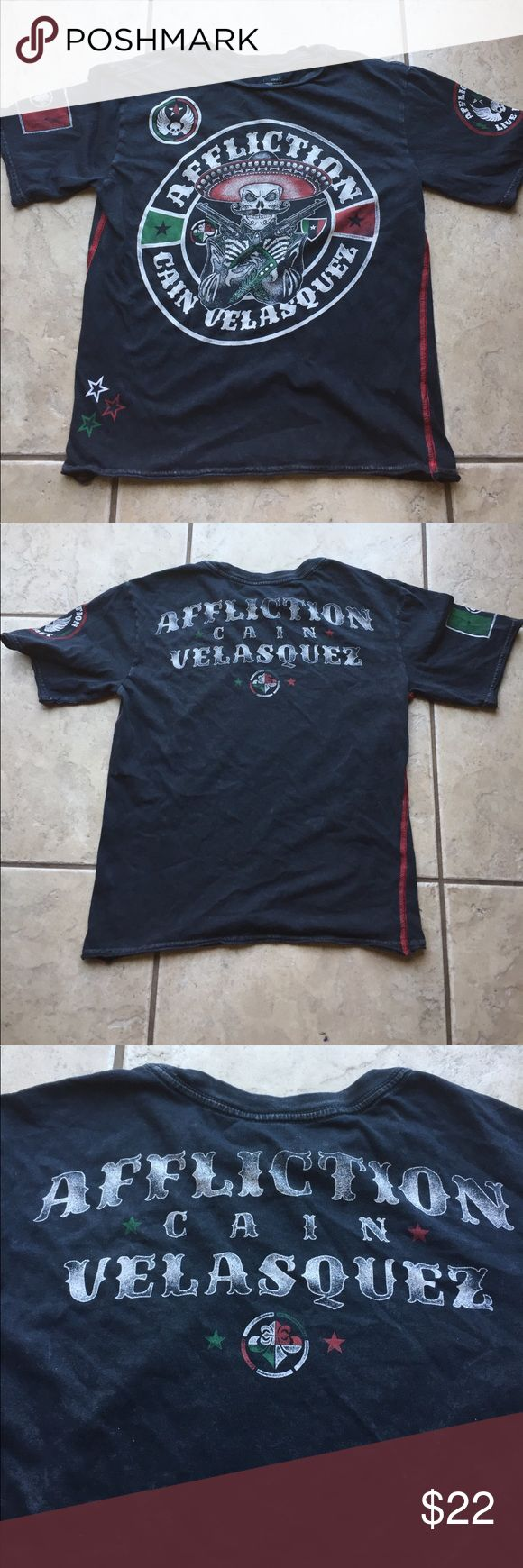 Affliction shirt (youth) This is in excellent used condition! Perfect for back to school! Cain Velasquez affliction. Has a distressed/faded look which was purchased like that. No holes/stains. Always hung to dry. Size Small for boys but fits a little smaller. This goes perfect with the BKE jeans in my closet 😍 Smoke/pet free home. Affliction Shirts & Tops Tees - Short Sleeve