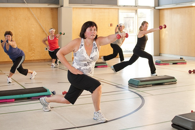 Many of our YMCA members enjoy using dumbbells and the aerobic step box in their aerobics fitness classes