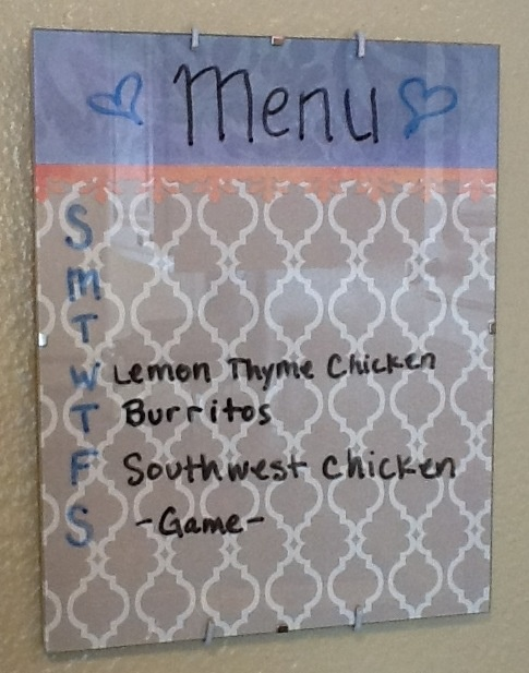 Frameless picture frame with a cute background= menu planner or just a cute dry erase board!