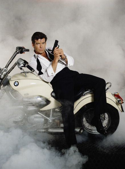 Irish actor Pierce Brosnan stars as 007 in the James Bond film 'Tomorrow Never Dies' 1997 He is sitting on a BMW R1200C in a publicity still for the...