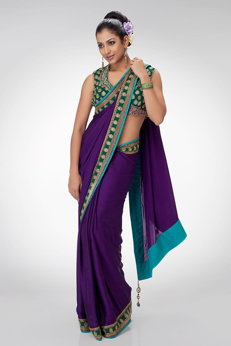 This plain purple saree is rendered extraordinary with emerald green border, which features golden embroidery. Edged with danglers, the saree will help you carve a niche at any party, festival or event. Shop online at www.satyapaul.com and visit us at www.facebook.com/SatyaPaulIndia