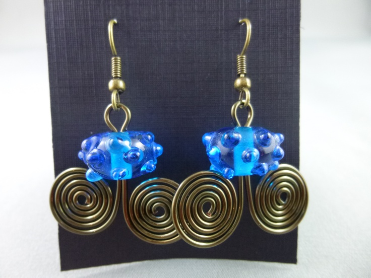 Blue lampwork beads added to a strand of spiraled bronze / copper wire and finished with plated surgical steel earwires.