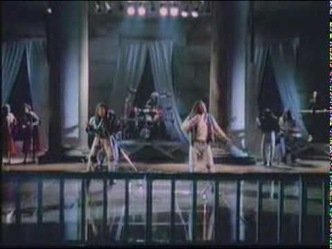 """Milli Vanilli -  Blame It On The Rain If you don't know of """"The Sandal"""" you will have to check it out-such a HUGE deal out of what shoulda been a bump in great careers for both the singers AND the """"front men"""""""