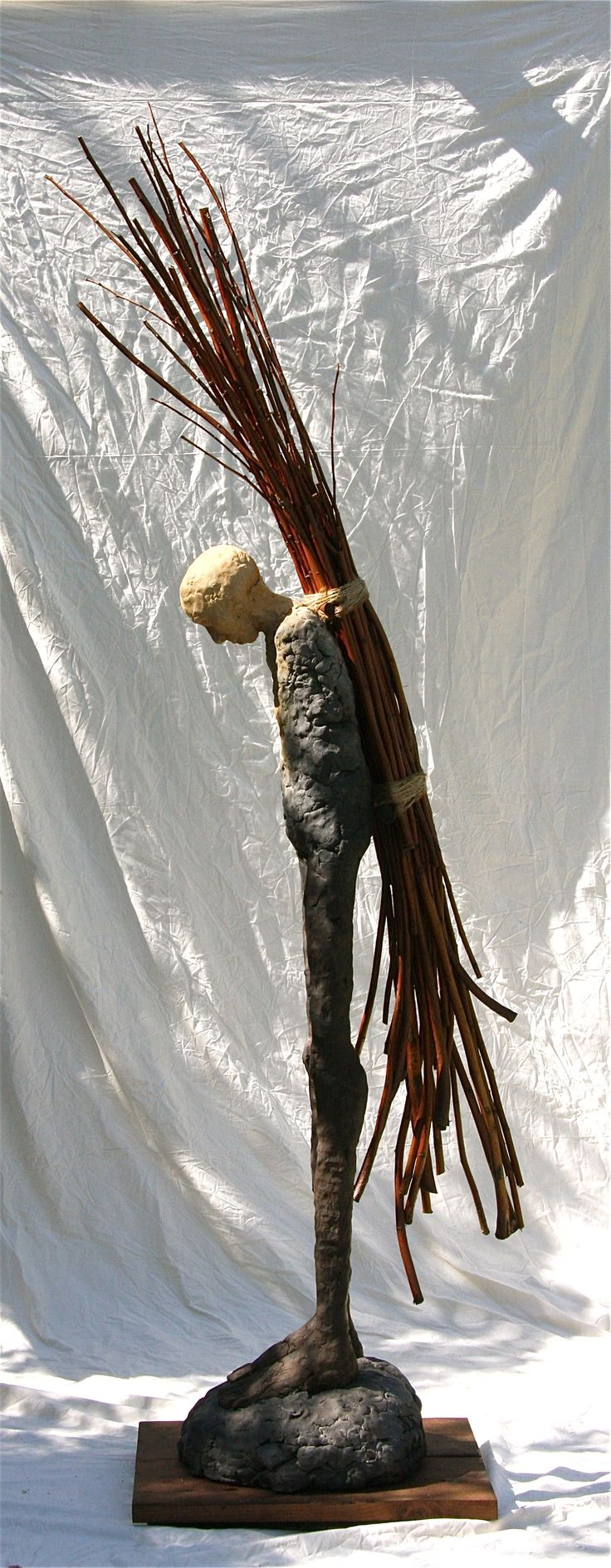 "To carry the old forest burdens. by William Catling, c. 2010 Ceramic, wood and twine 108"" x 18"" x 30"""