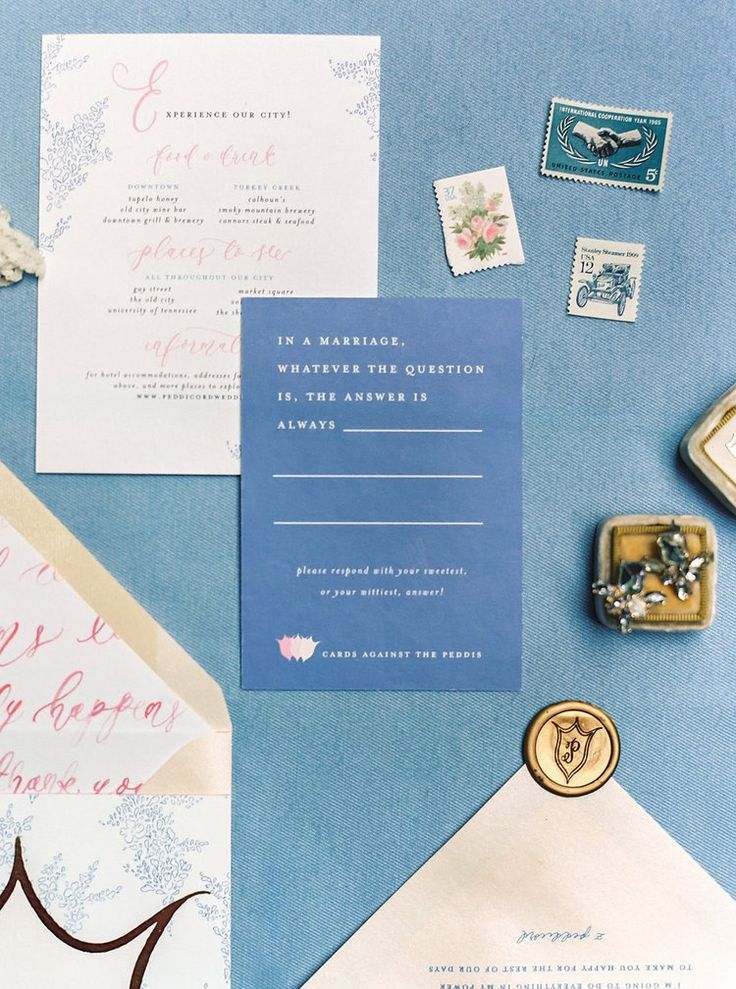 We love playing Cards Against Humanity, so we incorporated it into our Response Card Design! Our guests loved filling these out! / Custom Watercolor Floral & Gold Foil Wedding Invitations with Watercolor Wedding Map, Custom Watercolor Wedding Crest, Gold Wax Seal & Calligraphy Envelope Liners Blush & Navy Wedding with Fuchsia, French Blue and Gold Accents | Simply Jessica Marie's Southern Wedding at Gettysvue Golf Course and Country Club in Knoxville Tennessee | Photo by Perry Vaile…