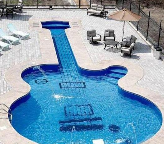 YEAH! Thats the guitar I wanna have :D I wonder who is able to make tabs for this guitar?  http://www.guitartabmaker.com/