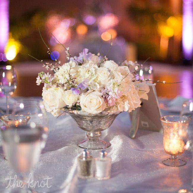 Low, rose centerpiece // photo: Liga Photography // Centerpiece: Flourish Floral Productions // Wedding: http://www.theknot.com/weddings/album/a-pastel-wedding-in-orlando-fl-110277