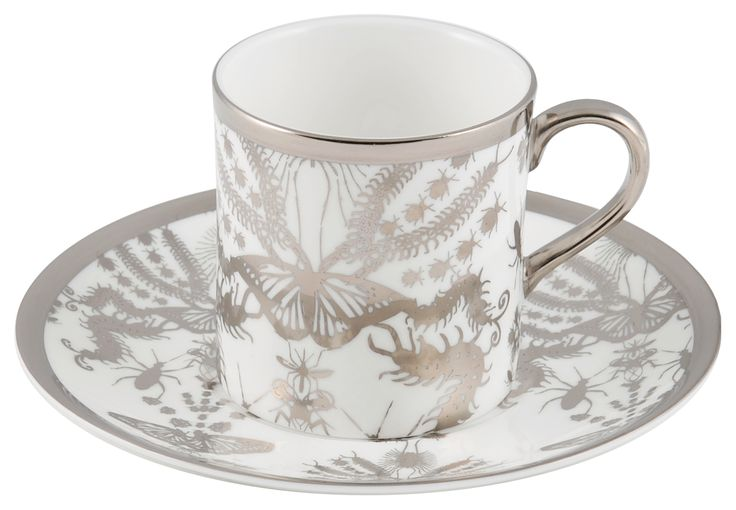 Espresso Cup & Saucer taken from the 'Entomo' Platinum range. A delicate and diverse set for your shot of coffee. Designed by Monica Tsang, 'Entomo' presents an array of some of the most important yet often misunderstood creatures on our planet. From gossamer wings of the butterfly to the architectural magnificence of the stag beetle, together a pattern of wonderment and delight. Hand gilded platinum rim and details. Available in Platinum and Black. Handwash Only. Made in Stoke-on-Trent…