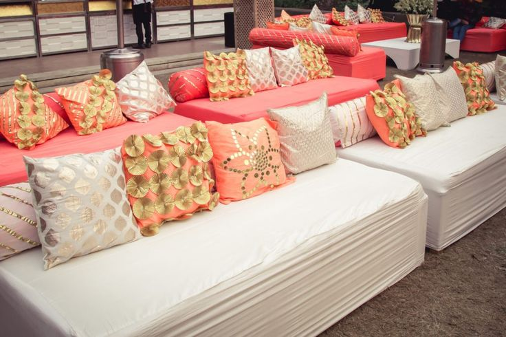 Every seating arrangement has cushions, so instead of covering them with simple cover, why not make them fancy with some gota work like these cushions.