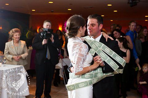 A Greek wedding tradition money wrapped around the couple.
