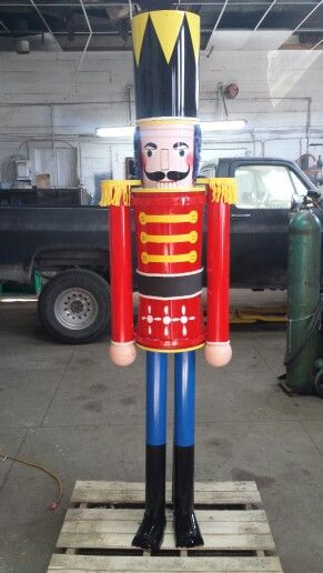 """7ft tall homemade nutcracker.  The body and head are buckets I bought from Lowe's.  The legs and arms are 3"""" pvc pipe. I saw a video on you tube that showed how to do this. I did have to add a stand made from rerod because it was wobbly."""