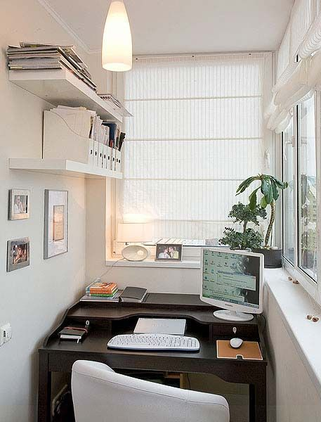 Home office on enclosed balcony.