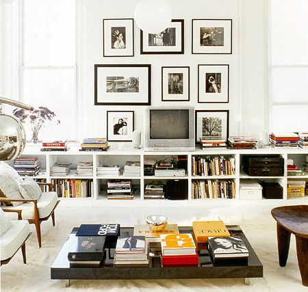 i want a living room with tall ceilings and windows, wall room for framed photographs, and book shelves stuffed with antique books. thx.