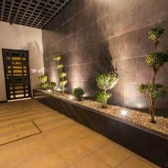 Casa AT: Pasillo, hall y escaleras de estilo translation missing: mx.style.pasillo-hall-y-escaleras.moderno por Cenit Arquitectos