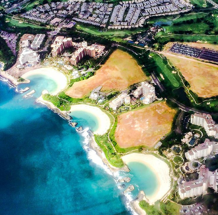 Ko Olina, Oahu, Hawaii, USA. Ko Olina has 2 miles (3.2 km) of coastal frontage and includes three natural and four man-made lagoons with white-sand beaches.