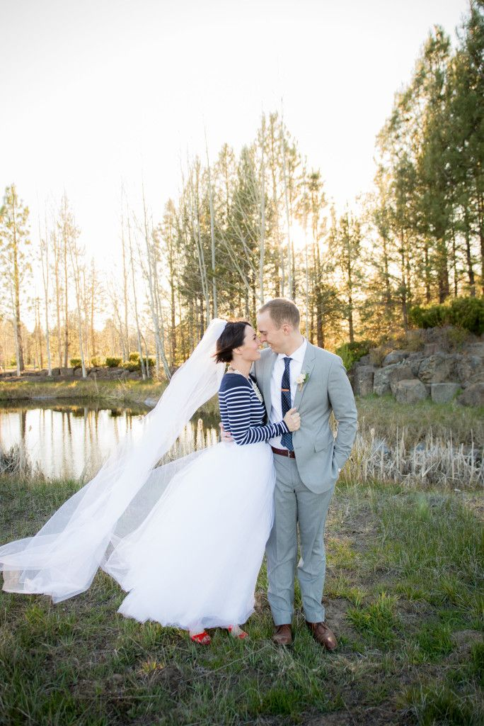 Nice Stylish and intimate Sunriver Bend Oregon wedding with bride wearing striped sweater and tulle skirt