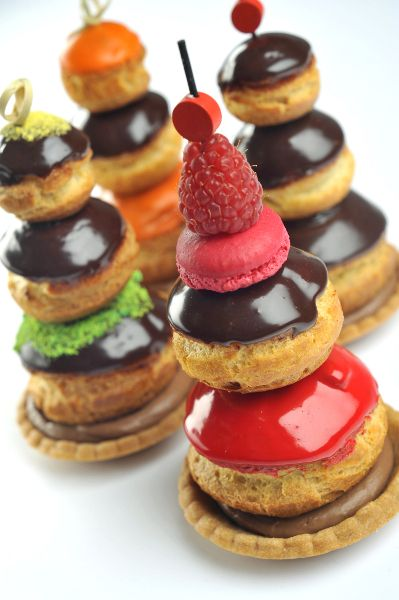 "Three choux puffs instead of one : les Religieuses Pas Très Catholiques, as I describe in my new book, ""Teatime in Paris"". http://www.christophe-roussel.fr/creations-gourmandise.html"