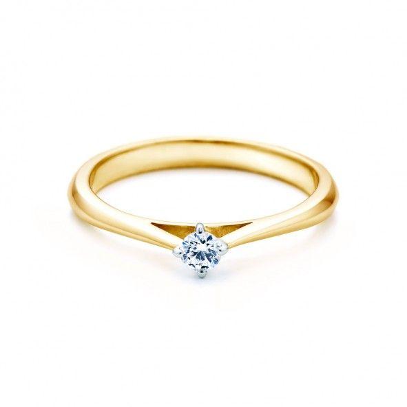 Pierścionek zaręczynowy z diamentem 0,05 ct o szlifie brylantowym wysokiej czystości SI1/G, wykonany z 18-karatowego żółto-białego złota (próba 0,750). Zapraszamy na www.savicki.pl/kolekcje/the-light-pl