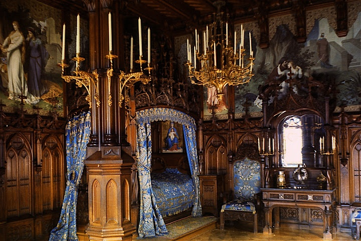 Detailing abounds in this ancient castle bedroom.