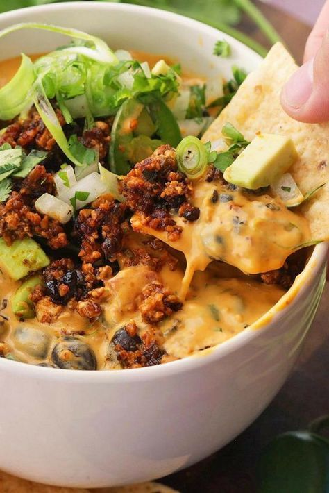 """Don't run away—our vegan """"cheese"""" sauce is as creamy and satisfying as the real thing, thanks to a base of vegetable shortening, potato, cashews, and almond milk. The vegan nacho cheese is addictive on its own, but it's even better piled with vegan chorizo, black beans, and avocado."""