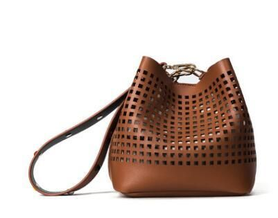 The Carissa bucket bag is a compact handbag with a modern spin on the classic style. a versatile boho bag for a life on-the-go has never looked so chic! Enjoy the supple leather that gives the Carissa bag its coveted elegance and sophisticated polish. This leather handbag features various interior pockets and is designed with ample room to store all your essentials.