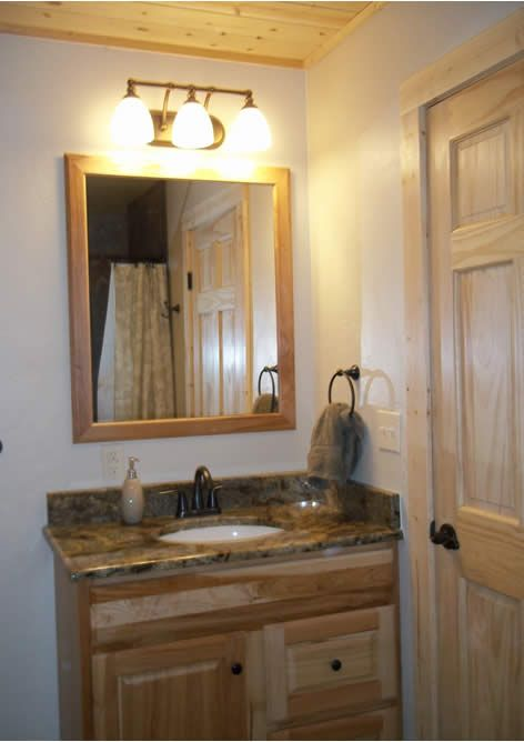 pretty cabin bathroom thinking hickory cabinets wall lowes medicine