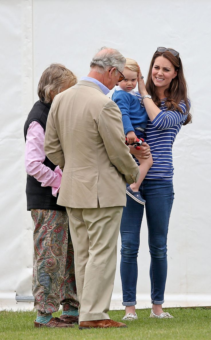 A tender moment between three generations at a polo match.