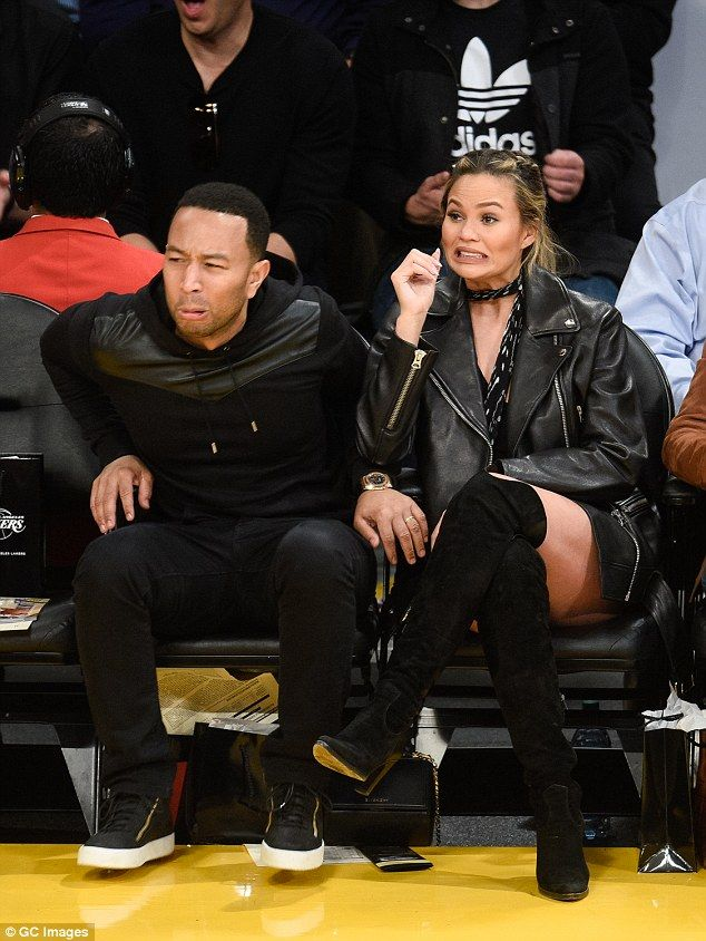 Animated: The couple pulled funny faces as they watchedthe Cavaliers take on the  Lakers...