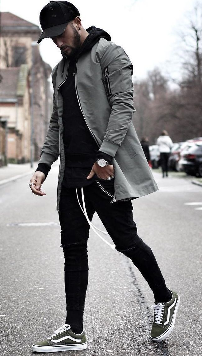 Black hoodie with black joggers and cap