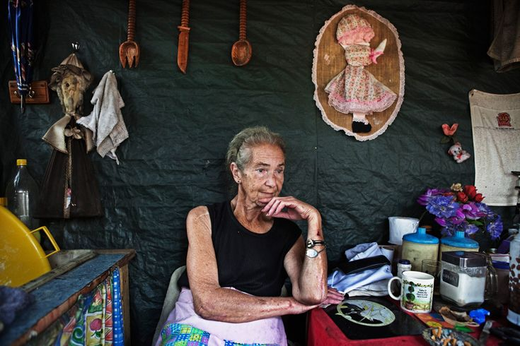 Mara Udwesthuizen, 64, sits outside her tent home in Krugersdorp on March 6, 2010. (REUTERS/Finbarr O'Reilly)