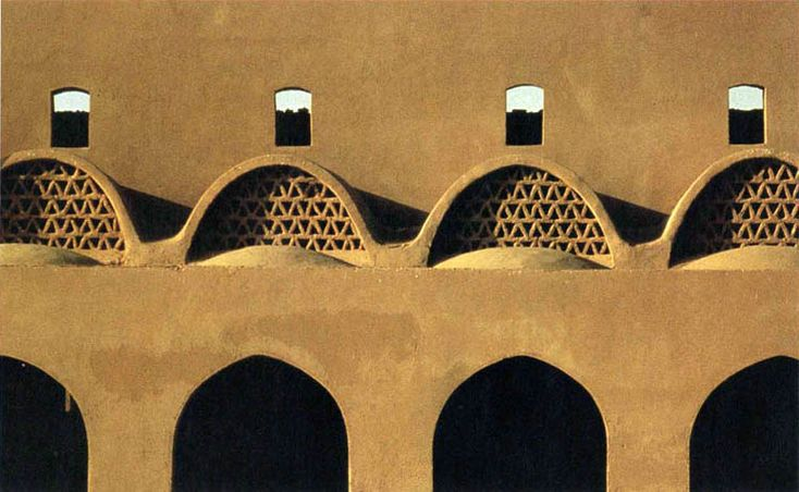 Hassan Fathy Egyptian Architect. The rhythmic arches of this loggia in the market at Bariz are based on Fathy's careful study of the indigenous towns of Egypt's Eastern Desert. Photo by Chant Avedissian - Aga Khan Trust for Culture