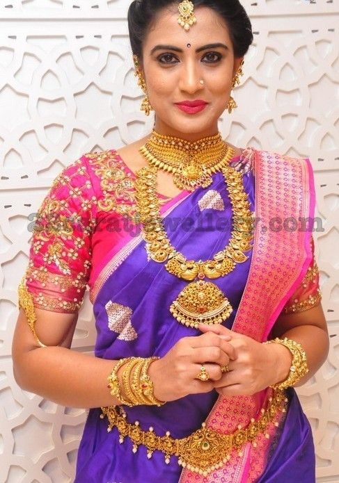 Model Triveni showcasing Traditional gold jewellery designs at Manepally jewellers. heavy antique necklace with simple mango cla...
