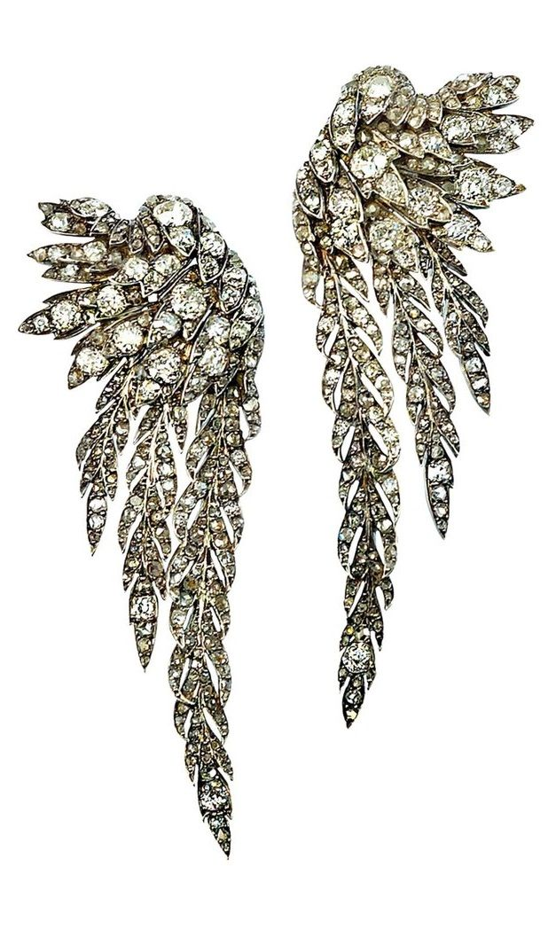 """A pair of Victorian silver-topped gold and diamond angel wing earrings, English, circa 1889. They are about 2 3/4"""" long and finished with a post and safety back."""