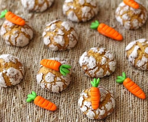 Carrot Cinnamon Crinkle Cookies |  It is a simple Easter delight.  These cookies have a crunchy exterior and a soft interior.  Plus, the cracked powdered sugar pattern makes for a beautiful cookie.  To make these cookies even more festive, serve them with fondant carrots or carrot candy.