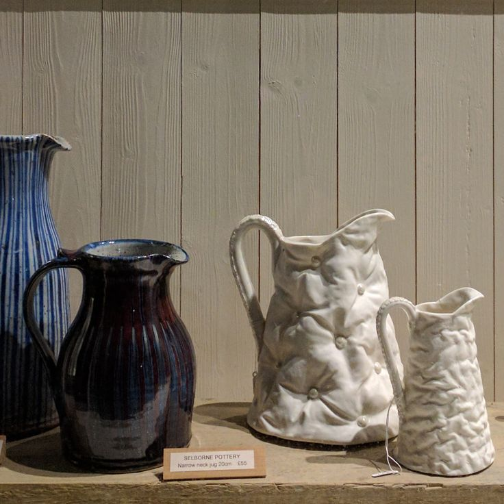 Love the way the night lights cast shadows on our window display . #inthewindow #sarahgrove #selbornepottery #allshapesandsizes