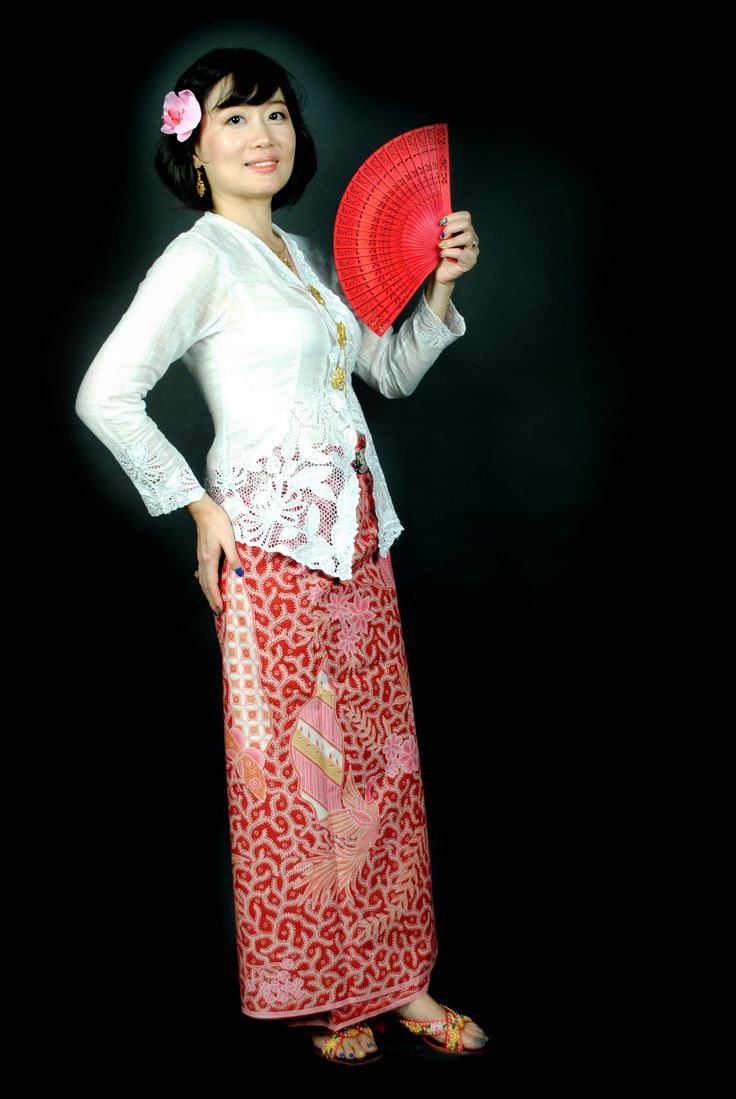 Little Nyonya Della on white kebaya and hipwrapper (kain panjang) red phoenix full hand drawn batik.