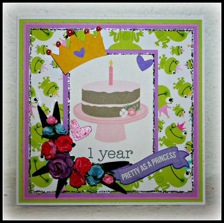 Ett årskort till en flicka - http://kristinasscrapbookingblogg.se/ett-arskort-till-en-flicka/ - Hej! Då var jag tillbaka här inne och tänkte visa er ett kort som jag har gjort till en liten söt flicka som fyller 1 år om några dagar.  Jag hittade ett sött papper från Bella Blvd  som jag har fått i ett DT paket och jag tyckte att det skulle passa perfekt till denna lilla prinsessa.  Jag...