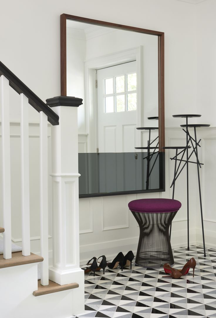 Contemporary Foyer Features A Industrial Style Modern Coat Hanger Placed Next To Wood Frame Wall Hung Mirror Accented With Black Film