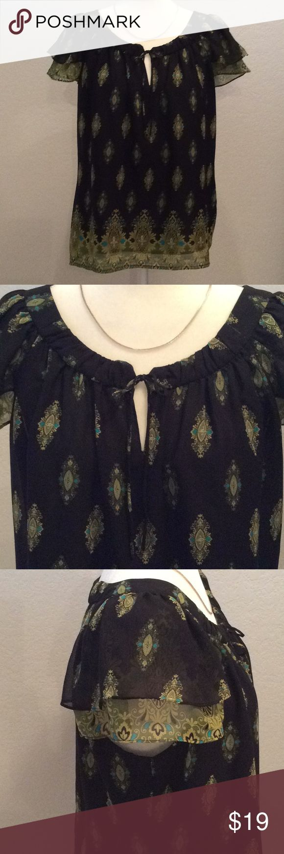 Apt.9 Capped Sleeve Dressy Top Apt. 9 Capped sleeve top size L. 100% Polyester and has a solid black lining to prevent see through. Great condition. Very cute! Pair with white shorts or capris for a Spring/Summer look! Apt. 9 Tops Blouses