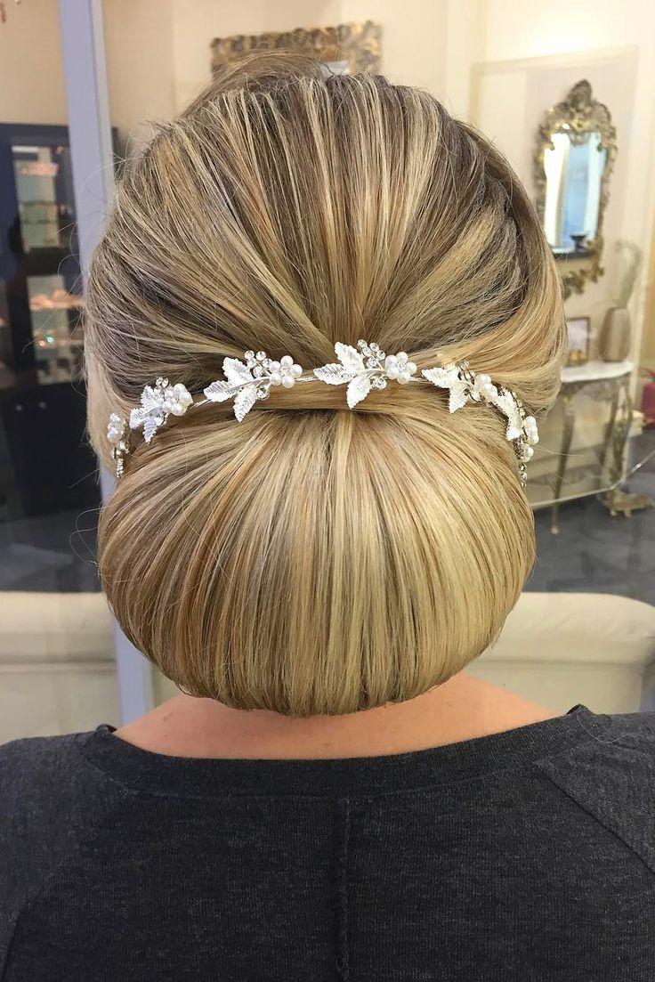18 Gorgeous Wedding Bun Hairstyles ❤ See more: http://www.weddingforward.com/wedding-bun-hairstyles/ #weddings #hairstyles