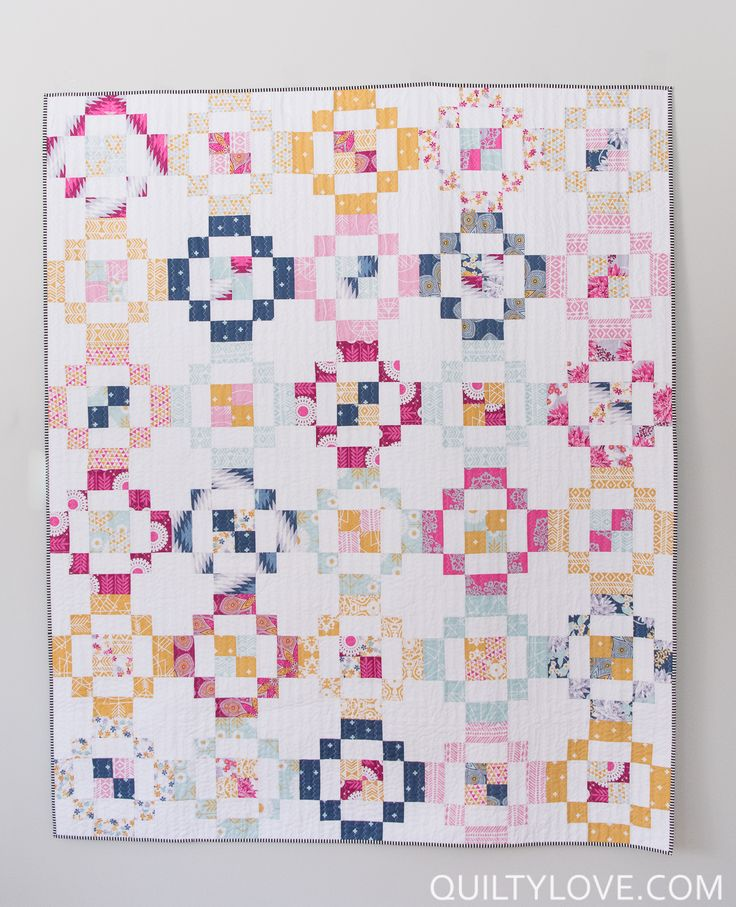 Quilty Love | Jelly Rings Quilt Pattern | http://www.quiltylove.com Click on through to see more photos of this Jelly Roll friendly quilt pattern using Free Spirits Wander fabric line by Joel Dewberry.