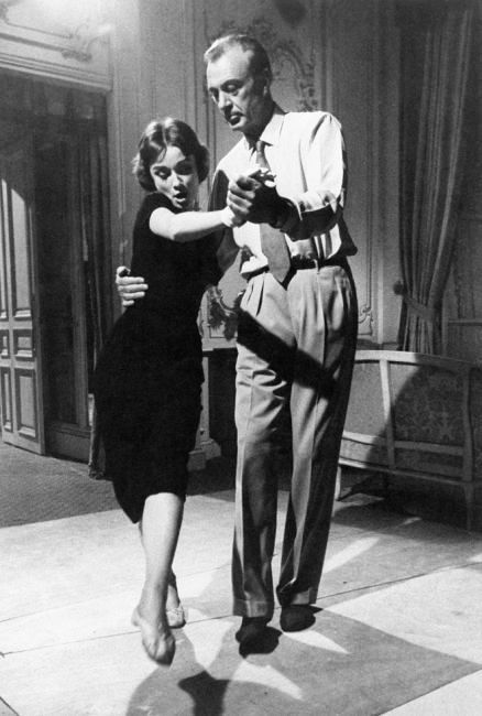 Audrey Hepburn and Gary Cooper dancing on the set of Love in the Afternoon.