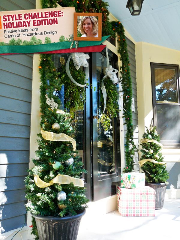 A Front Door Adorned With Garland Wreathes Small Trees And Swags Of Greenery Holiday