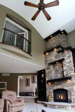 8 Ways to light your fireplace for maximum effect | Fox News -Love the stacked stone and dark wood too.