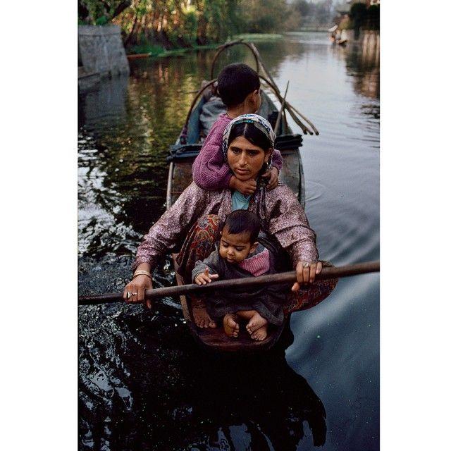 A woman with her children paddles a shikara near Dal Lake in Srinagar, Kashmir. Shikaras are made of deodar trees, also known as trees of God or divine wood. #Woman #Children #shikara #DalLake #Kashmir #photooftheday @magnumphotos