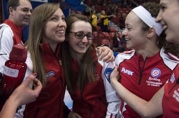 Rachel and team congratulating Cheryl Kreviazuk on her first game at the 2015 Scotties
