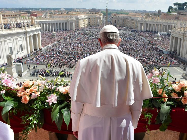 "Pope Francis addresses the crowd prior to delivering his Urbi et Orbi (to the city and to the world) message from the main balcony of St. Peter's Basilica, at the Vatican, Sunday, April 16, 2017. On Christianity's most joyful day, Pope Francis lamented the horrors generated by war and hatred, delivering an Easter Sunday message that also decried the ""latest vile"" attack on civilians in Syria. L'Osservatore Romano/Pool Photo via AP"