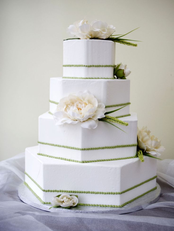 A wedding cake with unique hexagon shaped tiers! Cake # 022. (Wedding Cake Unique)