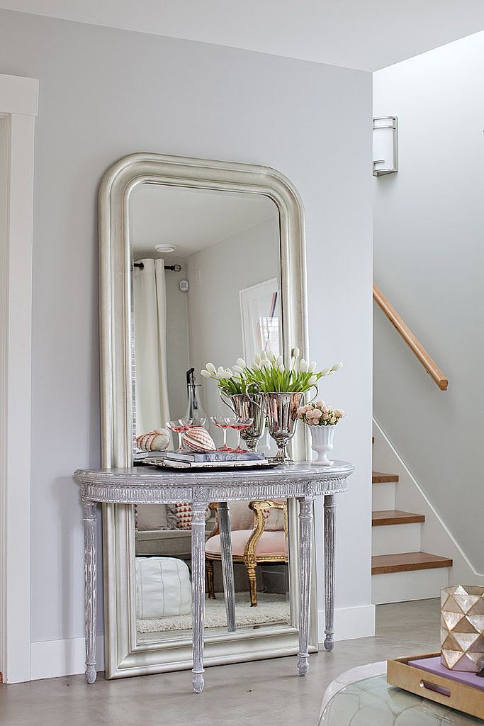 If you have room for a console, you have room for a tall mirror. Make the most out of it by layering a wall-busting mirror behind your console. Source: Janis Nicolay Photography